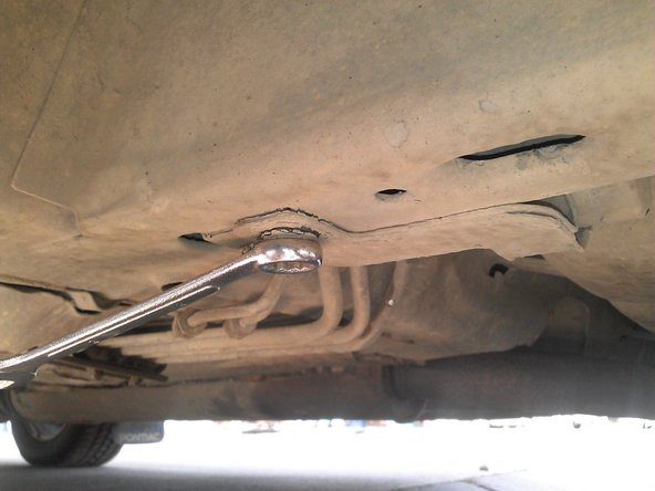 Remove the bolt holding the fuel filter brace in place. Put this bolt somewhere you will not lose.