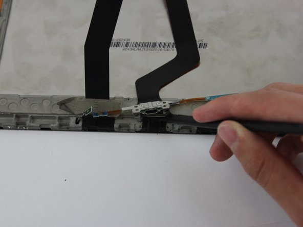 Image 2/2: Make sure to also disconnect the other end of the ribbon as well by pushing back the thin black metal bar.