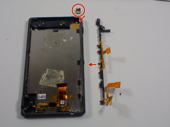 Next pry off the long plastic piece that goes around the perimeter of the left side of the phone. This is the part that contain the volume and power botton.  The little component where the camara goes will need to be removed.Be careful when removing the front camera components because there is adhesive tape under it.