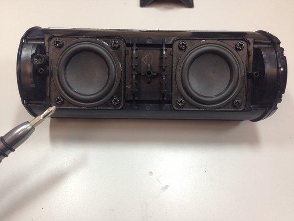 Remove all 8 speaker screws using a Philips 00 screwdriver.