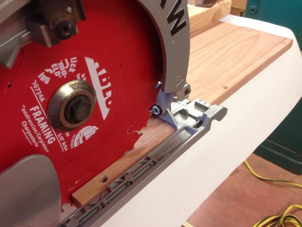 Cut along the wooden piece. Gently apply pressure on the corner for a clean straight cut.