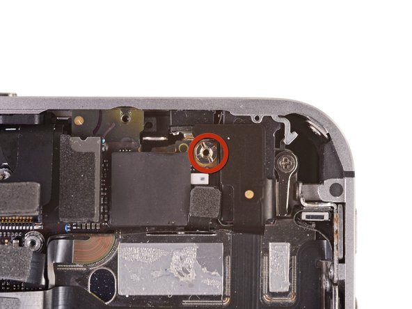 Remove the 4.8 mm standoff screw near the headphone jack.