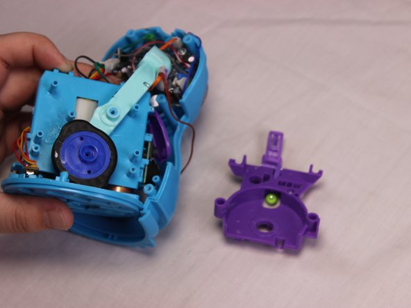 Remove the purple plastic casing. It should come off with little resistance.