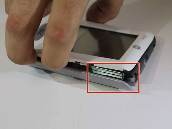 Remove the front part of the device from the bottom part of the device.