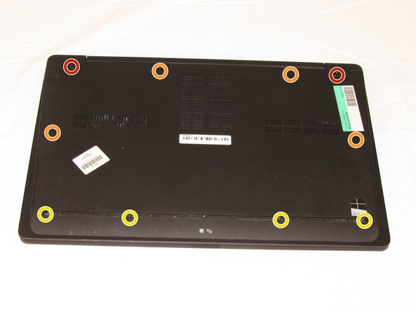 Remove the following ten screws from the bottom case of the laptop: