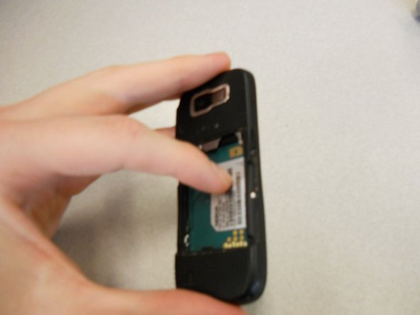 DO NOT PULL APART! There is a wire attaching the speaker to the rear case. It is very important to NOT sever this connection. Because of this, the rear case does not completely detach from the rest of the phone.