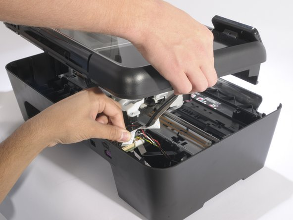 When all three cables are removed, lift the hood away from the printer and set it aside.