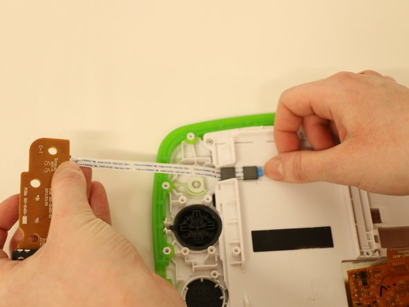 Image 1/1: Fully remove the speaker board from the device by gently pulling the ribbon cables out of the slot.