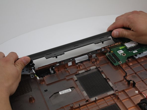 Pry the plastic backing that is under the screen upward with your fingers to remove it.