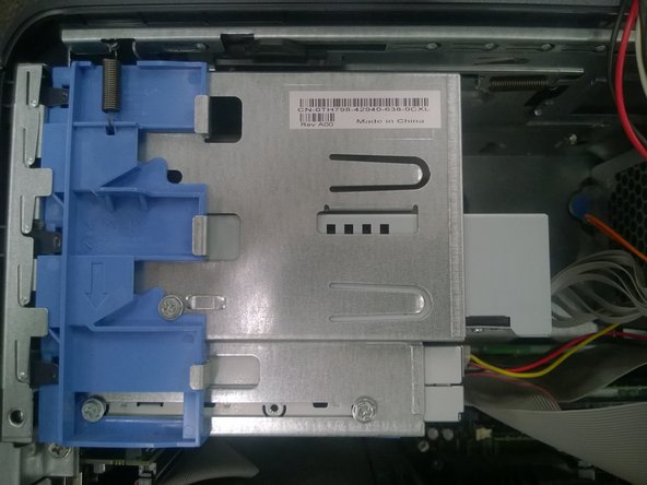 To remove the optical drive from the drive bay, slide the drive towards the front of the computer.