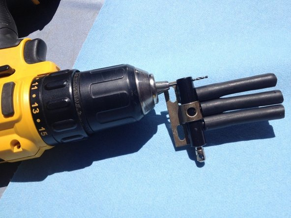 "Use a drill with a 1/16"" bit to drill a small hole from top through to the bottom of the switch body at the very back of the body, on the opposite side of the piston shaft."