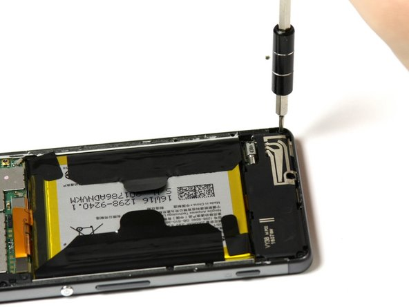 Remove the four 4mm screws holding the loudspeaker in place with a Phillips #00 screwdriver.