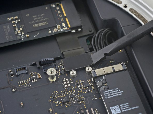 Lift the PCIe SSD connector up off its socket.