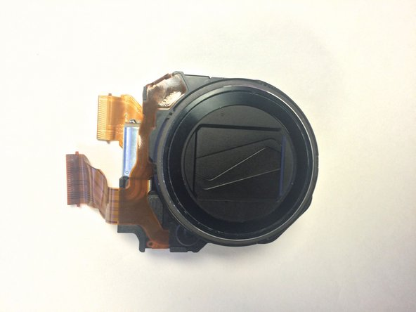 Once the ribbons are detached, the lens is now completely detached from camera and can be replaced.