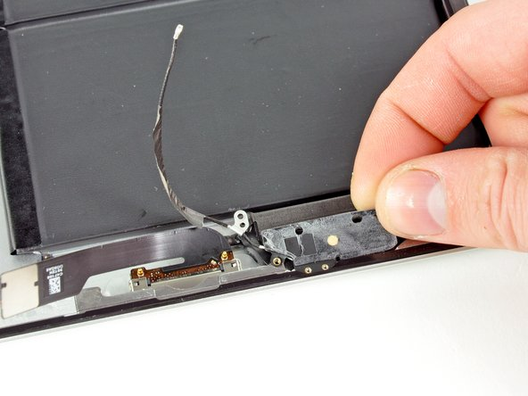 Image 1/1: Peel the bluetooth/wi-fi antenna off the speaker enclosure and remove it from the iPad 2.