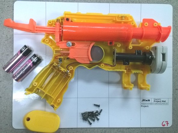 Image 3/3: Lift the side of the blaster off exposing its internal parts.
