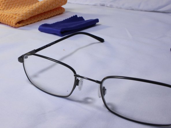 How can you remove scratches from eyeglasses?