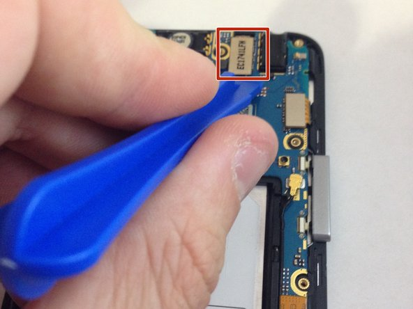 Locate the ribbon cables in the top right corner of the motherboard. Using the plastic opening tool, remove the ribbon cables from phone.