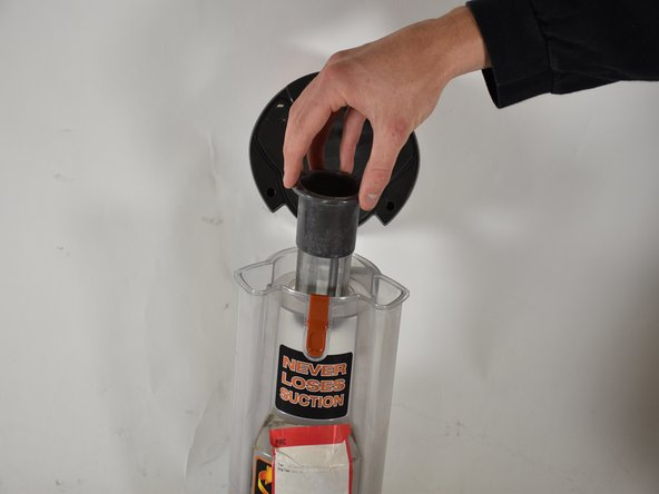 Find the cylindrical screen in the center of the dust cap, grab the top,  and pull it straight out.