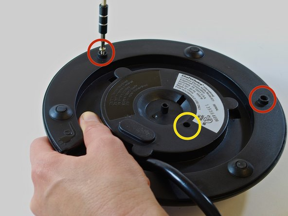 "Using a #1 Phillips head screwdriver, tighten the three 3/8"" Philips head screws in the holes located along the outer edge of the base plate."