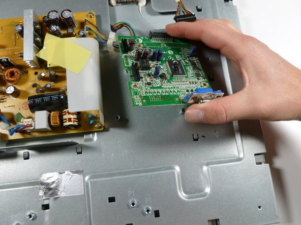 Remove the three 7.7 mm Phillips #2 screws from the motherboard, and take out the motherboard by lifting it up.