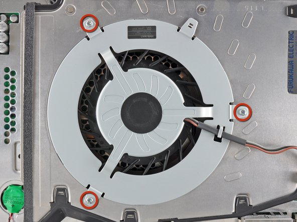 Image 1/1: Remove the three 5.7 mm #0 Phillips screws securing the fan to the heat sink.