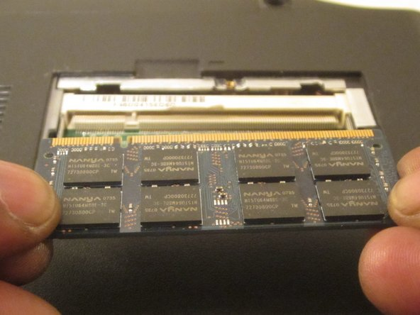Once you move the tabs, the RAM module will pop up and you can remove it with your fingers so you can put in a replacement.
