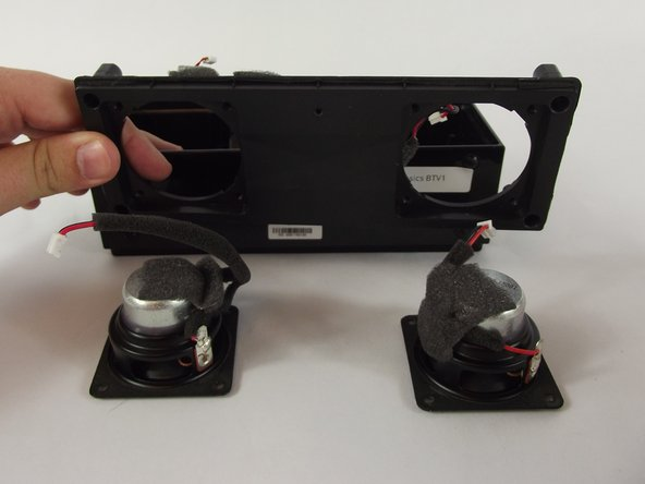 Image 2/2: Lift the front panel of the case and remove the speakers.