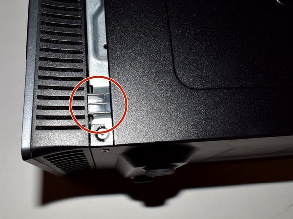 Safely place the computer down on its side and slide the panel off the case.