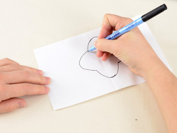 "Draw any the shape you'd like your patch to be on a piece of paper. Be sure your design is at least 1/8"" larger than the damaged area."