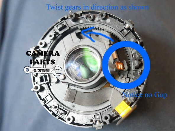 Ok so here is how to remove the inner barrel.  Twist the gear teeth in the direction of the arrow as far as it will go until you get a gap similar to picture #2