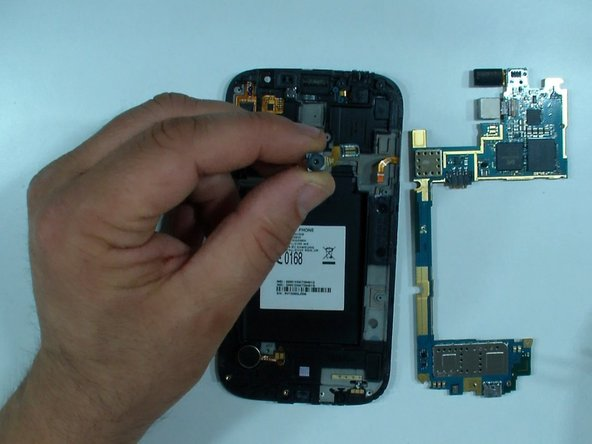 Image 1/2: Disconnect the touchscreen flex cable and unstuck it from the middle frame.