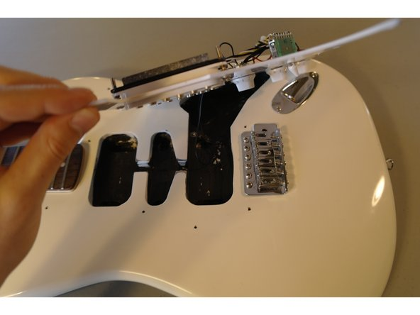 Flip the pickup guard to expose the wiring.