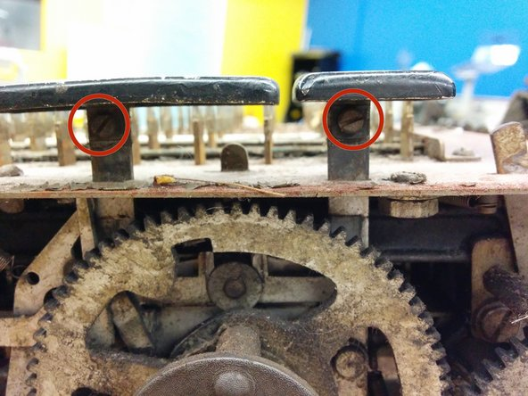 "Remove the screws holding the add and subtract keys. They are #4-48, 3/16""."
