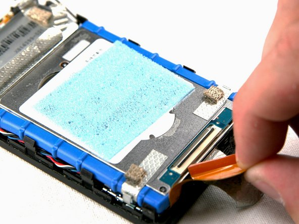 Image 2/3: Now gently pull the orange hard drive cable to remove it from the hard drive.