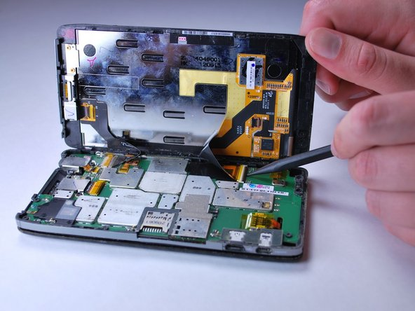 Image 1/2: Make sure to remove the flex cables before completely removing the screen.