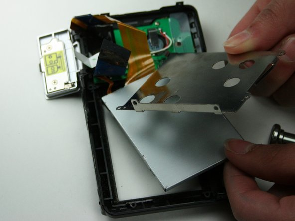 Lift out and remove the metal plating  over the LCD screen.
