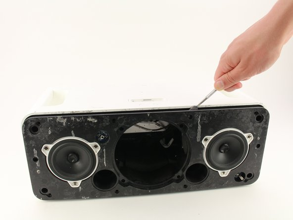 Pull the entire front assembly off by prying it up with the spudger and lifting the assembly off with your hands towards the top of the Hi-Fi.