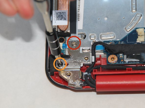 Remove the two screws from the metal hinge on the power button side using the PH0 screwdriver.