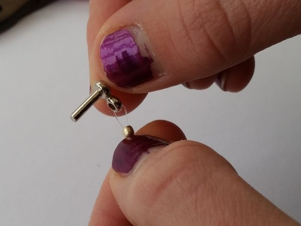 Image 1/1: Push the crimp bead up as close as you can to the clasp.