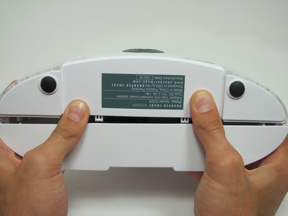 Once you remove the screws, pick the device up so that the grey label on the bottom of the device faces toward you.