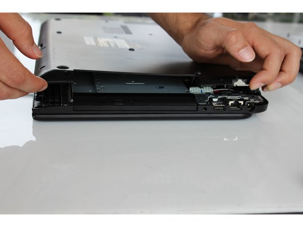 Use your fingers to finish removing the casing from the device.