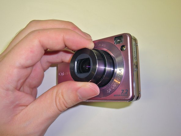 To begin, power the camera on so that the lens extends fully.  While the lens is extended, eject the battery as described in step one.  Otherwise, the camera will retract the lens.