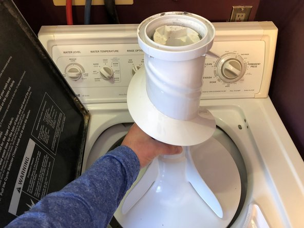 Remove agitator from washer tub by pulling straight up.