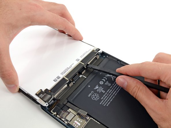 While still holding the LCD up with one hand, move on to the iPad's left side and repeat the previous step's procedure to separate the second piece of tape.