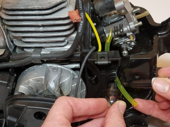 Attach one end of the new fuel line to the  incoming fuel port on the carburetor