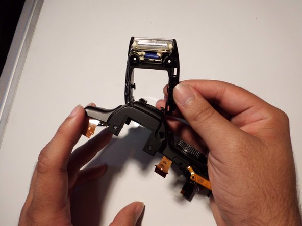 Image 1/1: Pull the wires gently through the top of the camera to completely remove the flash module.