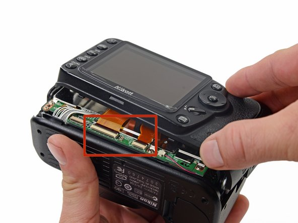 Image 1/1: The orientation shown in the picture seems to be the best position for the casing to sit comfortably without stressing the ribbon cable connections.