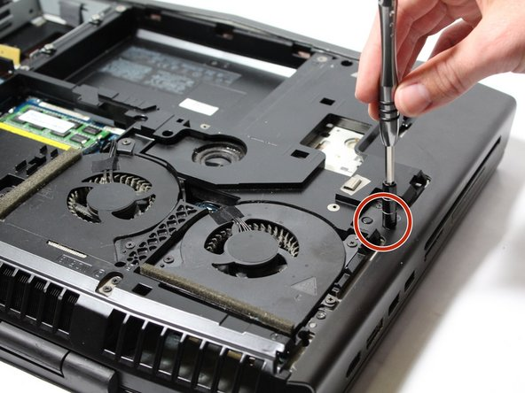 Remove the two indicated screws with the J000 screwdriver.