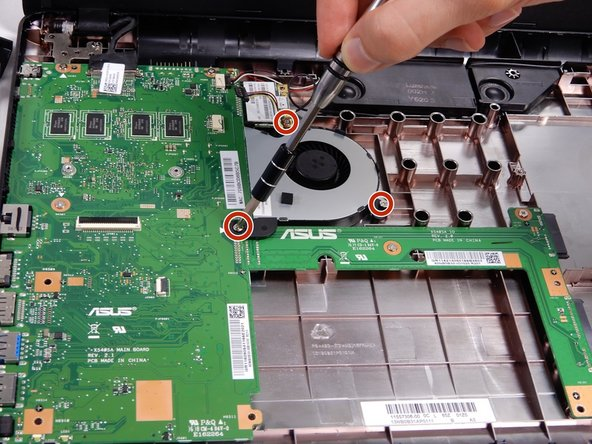Using the J00 screw bit in the iFixit tool kit, remove the three screws securing the fan to the case. One screw connected to the bottom case (4cm), one connected to the motherboard (4cm), and one screw connected to the Wireless Card (5cm).